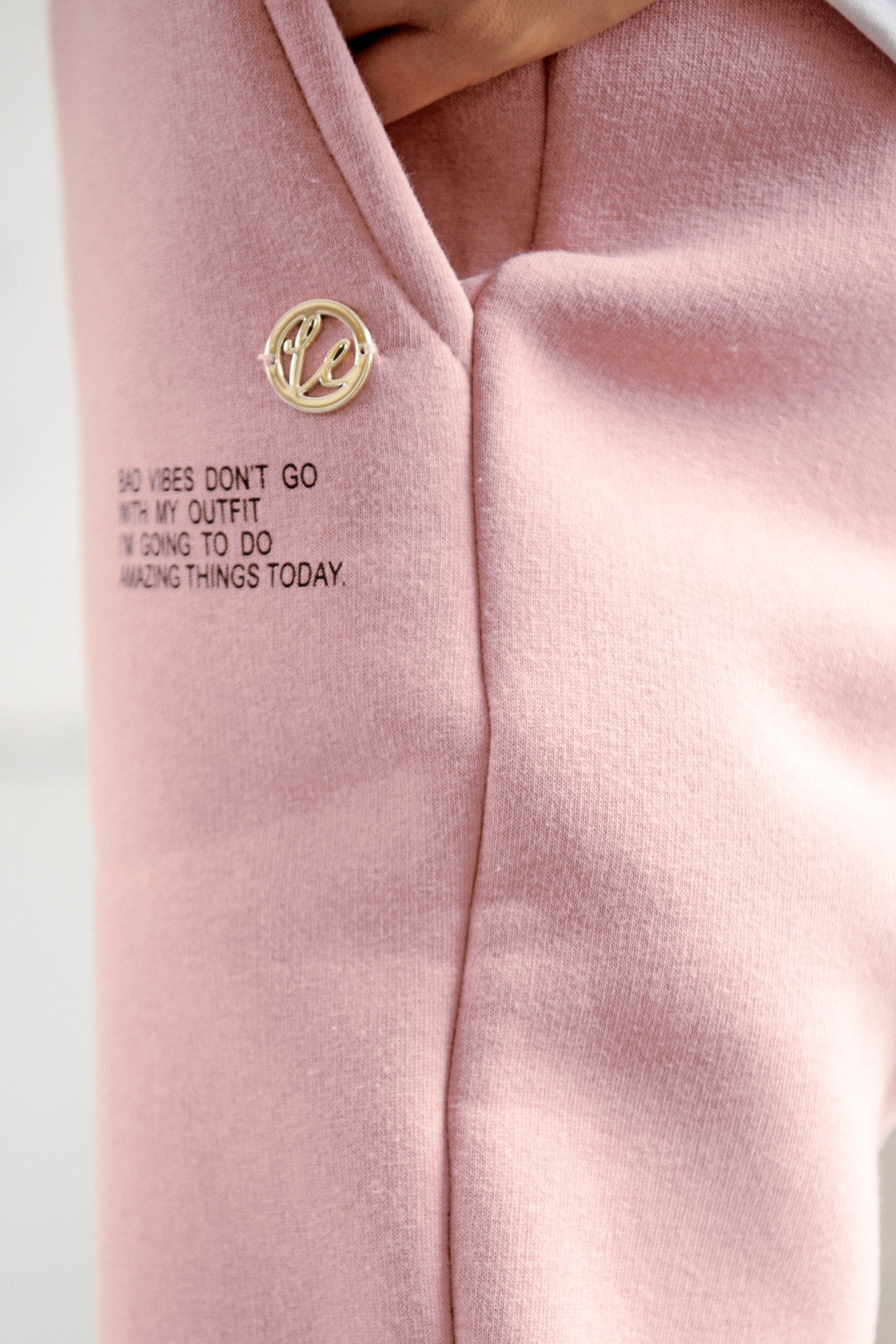 Jogginghose mit Statement Print in Powder Pink